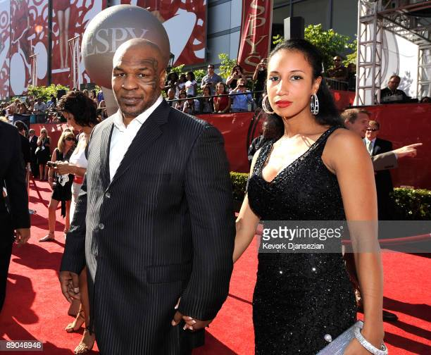 Former heavyweight champion Mike Tyson and wife Lakiha Spicer arrive at the 2009 ESPY Awards held at Nokia Theatre LA Live on July 15, 2009 in Los...