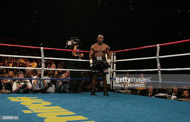 "Former heavyweight champion Mike Tyson waits in the ""neutral corner"" after inflecting a ruled intentional head-butt against opponent Kevin McBride of..."