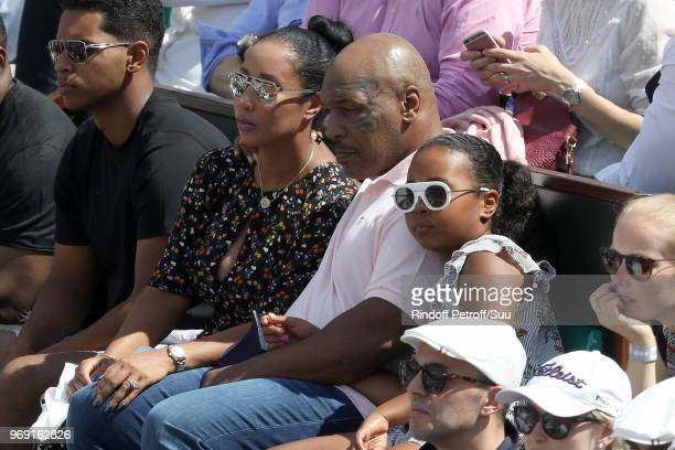 Former heavyweight champion Mike Tysonhis daughter Milan and his wife Lakiha attend the 2018 French Open Day Twelve at Roland Garros on June 7 2018...