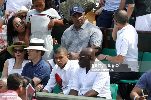 Former heavyweight champion Mike Tysonhis wife Lakiha Spicerhis daughter Milan and footballer Kylian Mbappe attend the 2018 French Open Day Eight at...