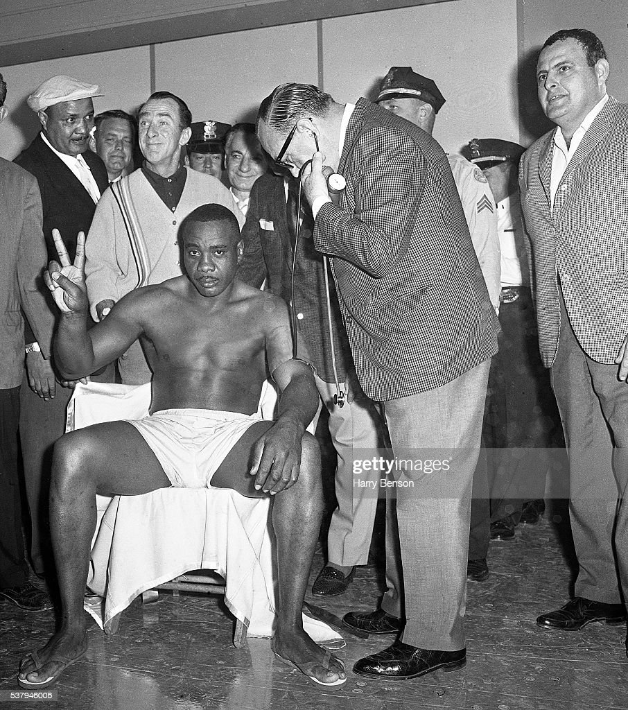 Former heavyweight champion Sonny Liston is photographed during the weigh in for the Clay vs Liston fight in Miami, Florida.