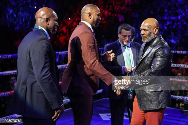 Former Heavyweight Champions Evander Holyfield Lennox Lewis and Mike Tyson are honored prior to the Heavyweight bout for Wilder's WBC and Fury's...