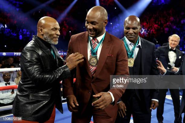 Former Heavyweight Champions Mike Tyson Lennox Lewis and Evander Holyfield are honored prior to the Heavyweight bout for Wilder's WBC and Fury's...