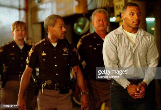 Former heavyweight world champion boxer Mike Tyson is led away in handcuffs from the appellate court in Indianapolis after his appeal against a rape...