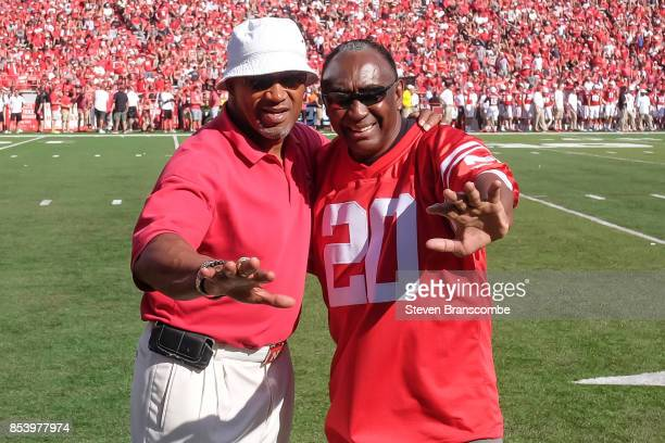 Former Heisman Trophy winners Mike Rozier and Johnny Rodgers pose during a break in the game between the Nebraska Cornhuskers and the Rutgers Scarlet...