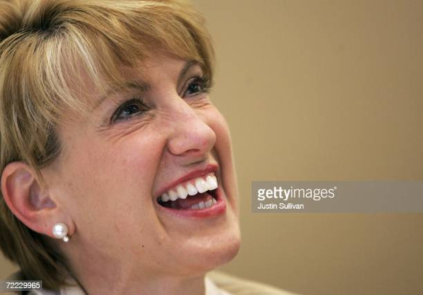 Former HewlettPackard CEO Carly Fiorina smiles as she signs copies of her new book 'Tough Choices' October 20 2006 in San Francisco California...