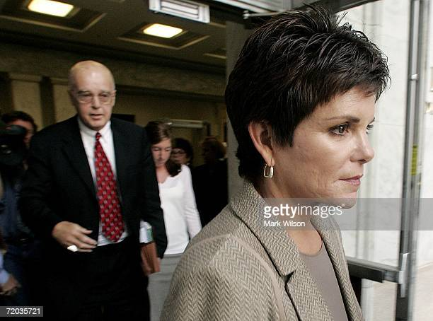 Former HewlettPackard Chairwoman Patricia Dunn walks with her attorney James Brosnahanout out of the Rayburn House Office Building after testifying...