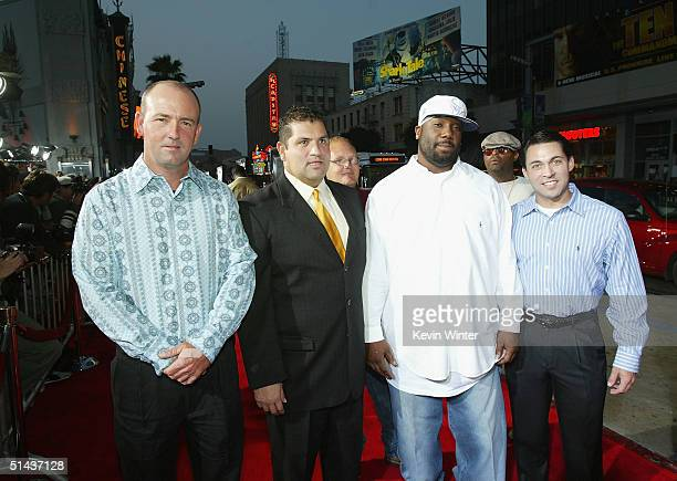Former high school football players portrayed in the film Mike Winchell Brian Chavez Boobie Miles and Don Billingsley pose at the premiere of...