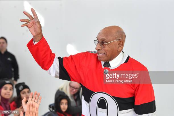 Former hockey player Willie O'ree salutes the guests during the 2017 Scotiabank NHL100 Classic Legacy Project press conference at the Boys Girls Club...