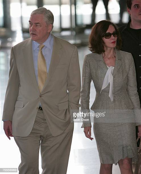 Former Hollinger International CEO Conrad Black leaves the federal courthouse with his wife Barbara Amiel following a hearing to determine if he will...