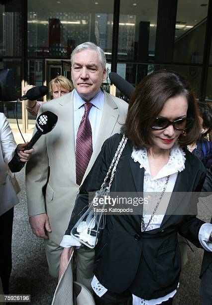 Former Hollinger International CEO Conrad Black leaves the federal courthouse with his wife Barbara Amiel following his bail hearing on August 1 2007...