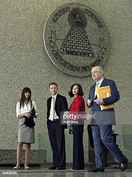 Former Hollinger International Chief Executive Officer Conrad Black right enters the Dirksen Federal Building for testimony in his Federal corruption...
