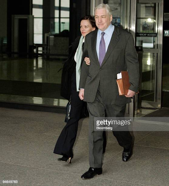 Former Hollinger International Inc Chief Executive Officer Conrad Black right leaves the Dirksen Federal Building with his wife Barbara Ameil after a...