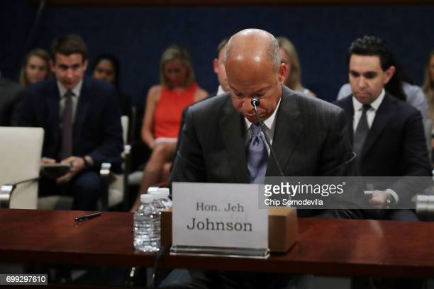 Former Homeland Security Secretary Jeh Johnson bows his head in prayer before testifying to the House Intelligence Committee in an open hearing in...