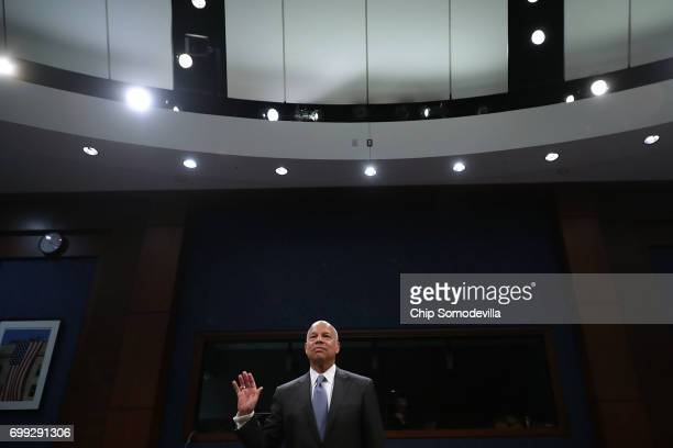 Former Homeland Security Secretary Jeh Johnson is sworn in before testifying to the House Intelligence Committee in an open hearing in the US Capitol...