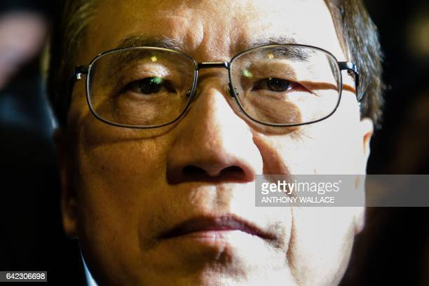 Former Hong Kong chief executive Donald Tsang looks on as he walks towards his car from the High Court after the jury found him guilty of misconduct...