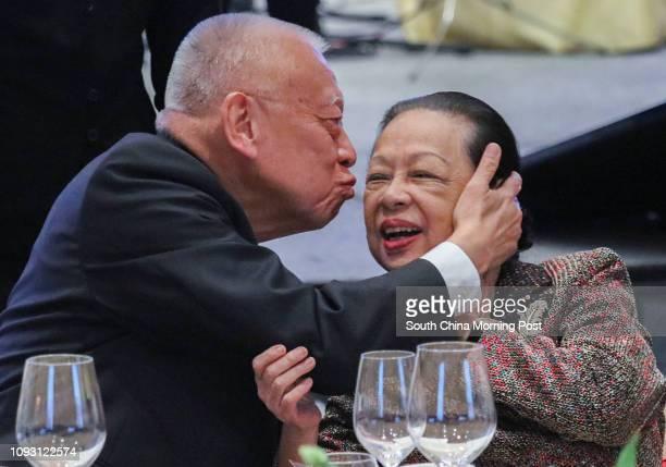 Former Hong Kong Chief Executive Tung Cheehwa gives his wife Betty Tung Chiu Hungping a kiss during the 3rd Anniversary of Our Hong Kong Foundation...