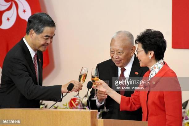 Former Hong Kong Chief Executives Leung Chunying and Tung Cheehwa and incumbent Hong Kong Chief Executive Carrie Lam Cheng Yuetngor toast glasses...