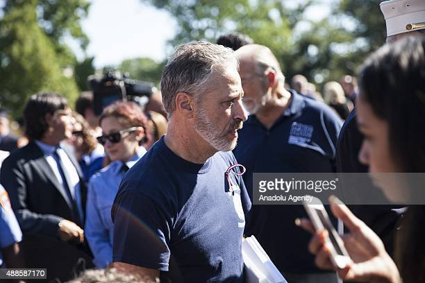 Former host of the Daily Show Jon Stewart answers questions after speaking at a Firefighters Rally for 9/11 first responders in front of the US...