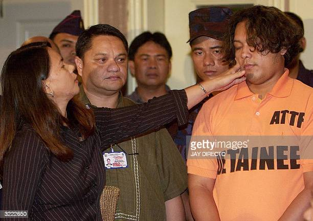 Former hostage Angie Montealegre slaps arrested Abu Sayyaf leader Alhamser Manatad Limbong when he was presented to the press along with five other...