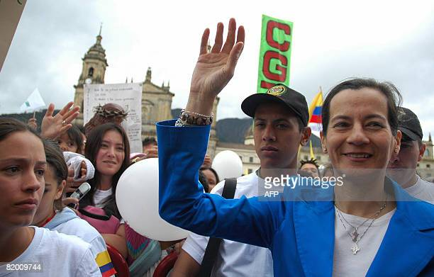 FARC former hostage Clara Rojas waves during a march to protest against the Revolutionary Armed Forces of Colombia leftist guerrillas and to ask for...