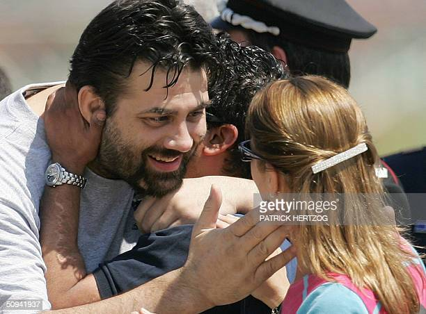Former hostage Maurizio Agliana is greeted by his sister Antonella as the three Italian hostages freed yesterday by coalition forces in Iraq arrive...