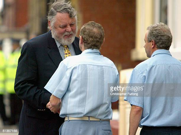 Former hostage Terry Waite is greeted by Stan and Philip Bigley the brothers of British hostage Kenneth Bigley September 25 in Liverpool England...