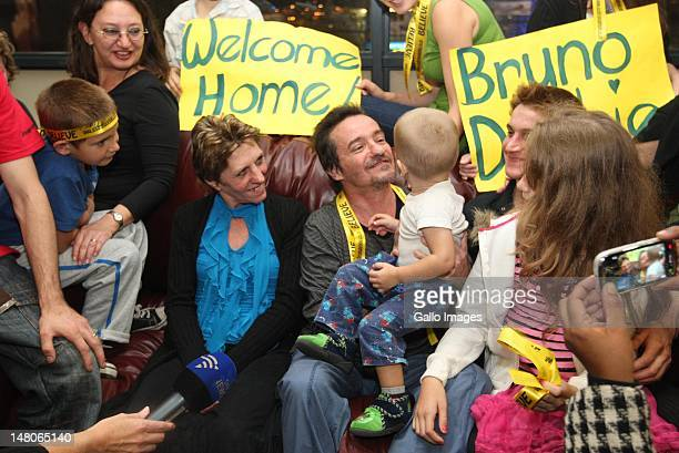 Former hostages Bruno Pelizzari and Deborah Calitz smile at Bruno Pelizzari's grandson Calvin Pelizzari after their arrival at King Shaka...