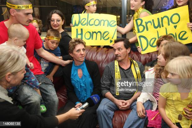Former hostages Bruno Pelizzari and Deborah Calitz with their friends and family after their arrival at King Shaka International Airport on July 7...