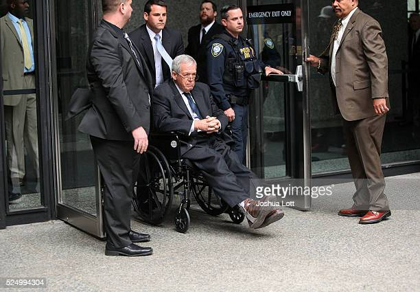 Former House Speaker Dennis Hastert leaves the Dirksen Federal Court House in a wheelchair after his sentencing on April 27, 2016 in Chicago,...