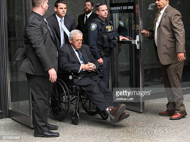 Former House Speaker Dennis Hastert leaves the Dirksen Federal Court House in a wheelchair after his sentencing on April 27 2016 in Chicago Illinois...