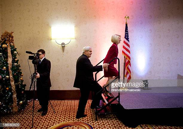 Former House Speaker Newt Gingrich and his wife Callista Gingrich arrive for a rally December 21 2011 in Arlington Virginia Former Speaker of the...