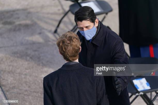 Former House Speaker Paul D. Ryan speaks to a guest during the inauguration of Joe Biden on the West Front of the U.S. Capitol on January 20, 2021 in...