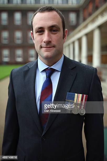 Former Household Cavalry Regiment soldier Chris Finney poses before being presented Specially Commissioned commemorative coin set at Royal Hospital...