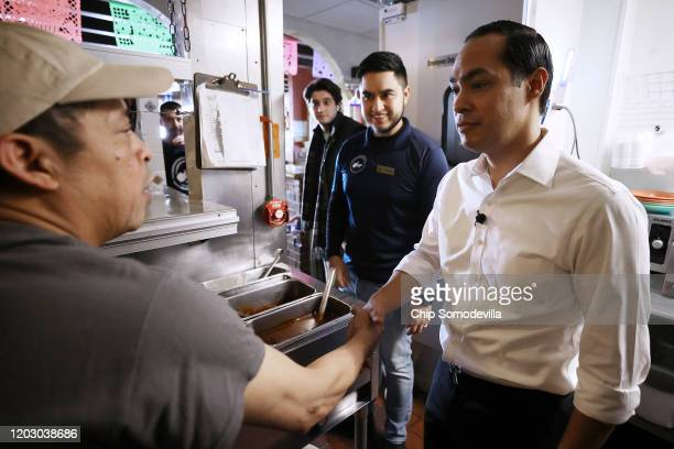 Former Housing and Urban Development Secretary Julian Castro greets employees of La Carreta restaurant while campaigning on behalf of Democratic...