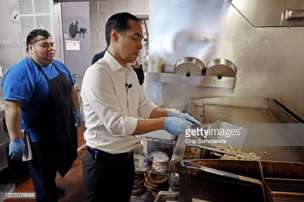 Former Housing and Urban Development Secretary Julian Castro grills chicken fajitas in the kitchen of La Carreta restaurant while campaigning on...