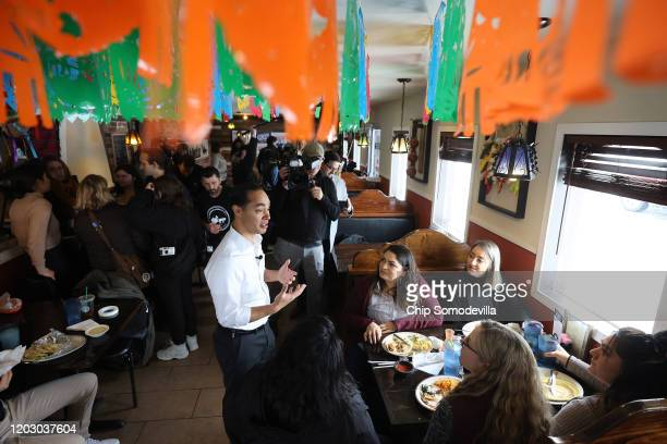 Former Housing and Urban Development Secretary Julian Castro talks with diners during a campaign event while stumping on behalf of Democratic...