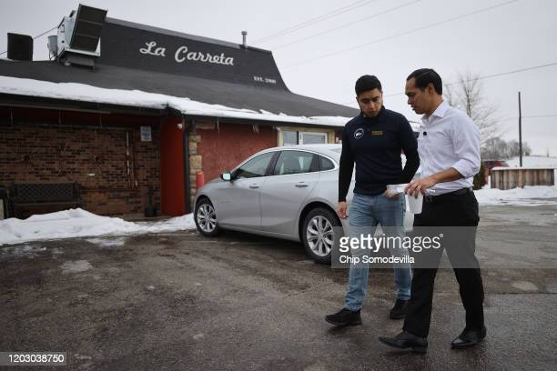 Former Housing and Urban Development Secretary Julian Castro talks with La Carreta restaurant owner Alfonso Medina Jr. While campaigning on behalf of...
