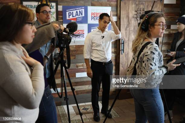 Former Housing and Urban Development Secretary Julian Castro waits for an interview while campaigning on behalf of Democratic presidential candidate...