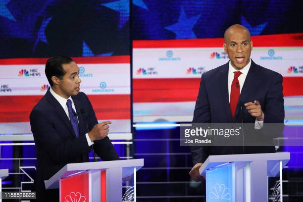 Former housing secretary Julian Castro and Sen. Cory Booker take part in the first night of the Democratic presidential debate on June 26, 2019 in...