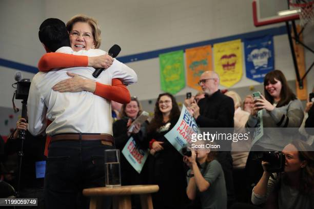 Former housing secretary Julian Castro joins Democratic presidential candidate Sen. Elizabeth Warren during a campaign stop at Fisher Elementary...