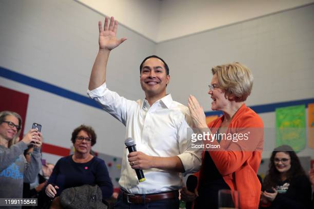 Former housing secretary Julian Castro joins Democratic presidential candidate, Sen. Elizabeth Warren during a campaign stop at Fisher Elementary...