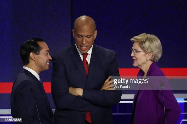 Former housing secretary Julian Castro Sen Cory Booker and Sen Elizabeth Warren talk during the first night of the Democratic presidential debate on...