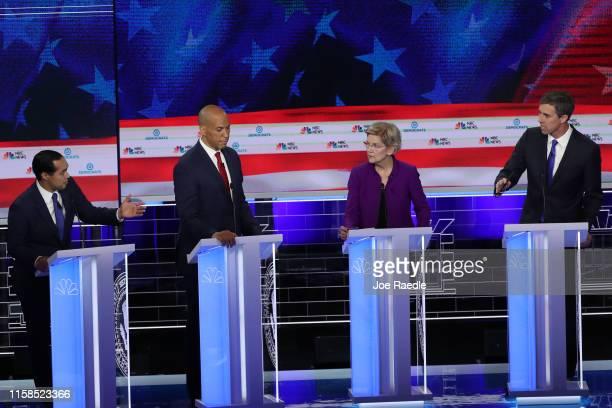 Former housing secretary Julian Castro Sen Cory Booker Sen Elizabeth Warren and former Texas congressman Beto O'Rourke take part in the first night...