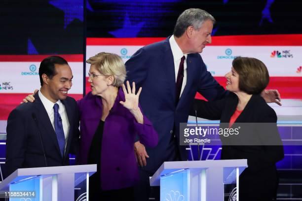 Former housing secretary Julian Castro Sen Elizabeth Warren New York City Mayor Bill De Blasio and Sen Amy Klobuchar embrace after the first night of...