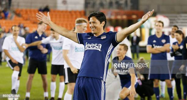 Former Houston Dynamo Brian Ching reacts after missing his shot during the Skillz Challenge during the Kick In For Houston Charity Soccer Match at...