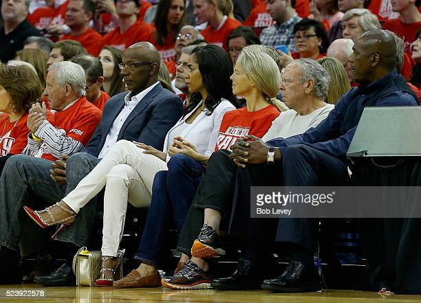 Former Houston Rockets' Clyde Drexler left sits with Rockets owner Leslie Alexander and Hakeem Olajuwon at Toyota Center on April 24 2016 in Houston...