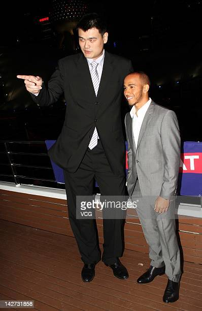 Former Houston Rockets player Yao Ming and Lewis Hamilton of Great Britain and McLaren attend a cocktail party as a part of the 'GREAT' campaign...