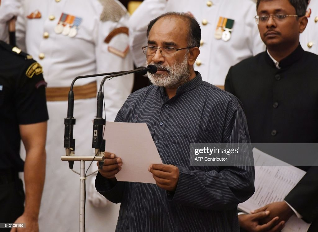 Former IAS officer Alphons Kannanthanam takes the oath during the swearing-in ceremony of new ministers at the Presidential Palace in New Delhi on September 03, 2017. Prime Minister Narendra Modi named a female legislator as India's new defence minister on September 3, the first time a woman has been appointed to the key portfolio overseeing border tensions with China and Pakistan. PHOTO / Prakash SINGH