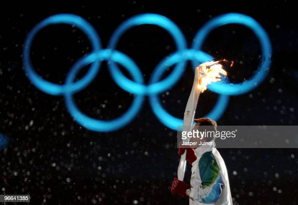 Former ice hockey player Wayne Gretzky takes part in the lighting of the Olympic flame during the Opening Ceremony of the 2010 Vancouver Winter...